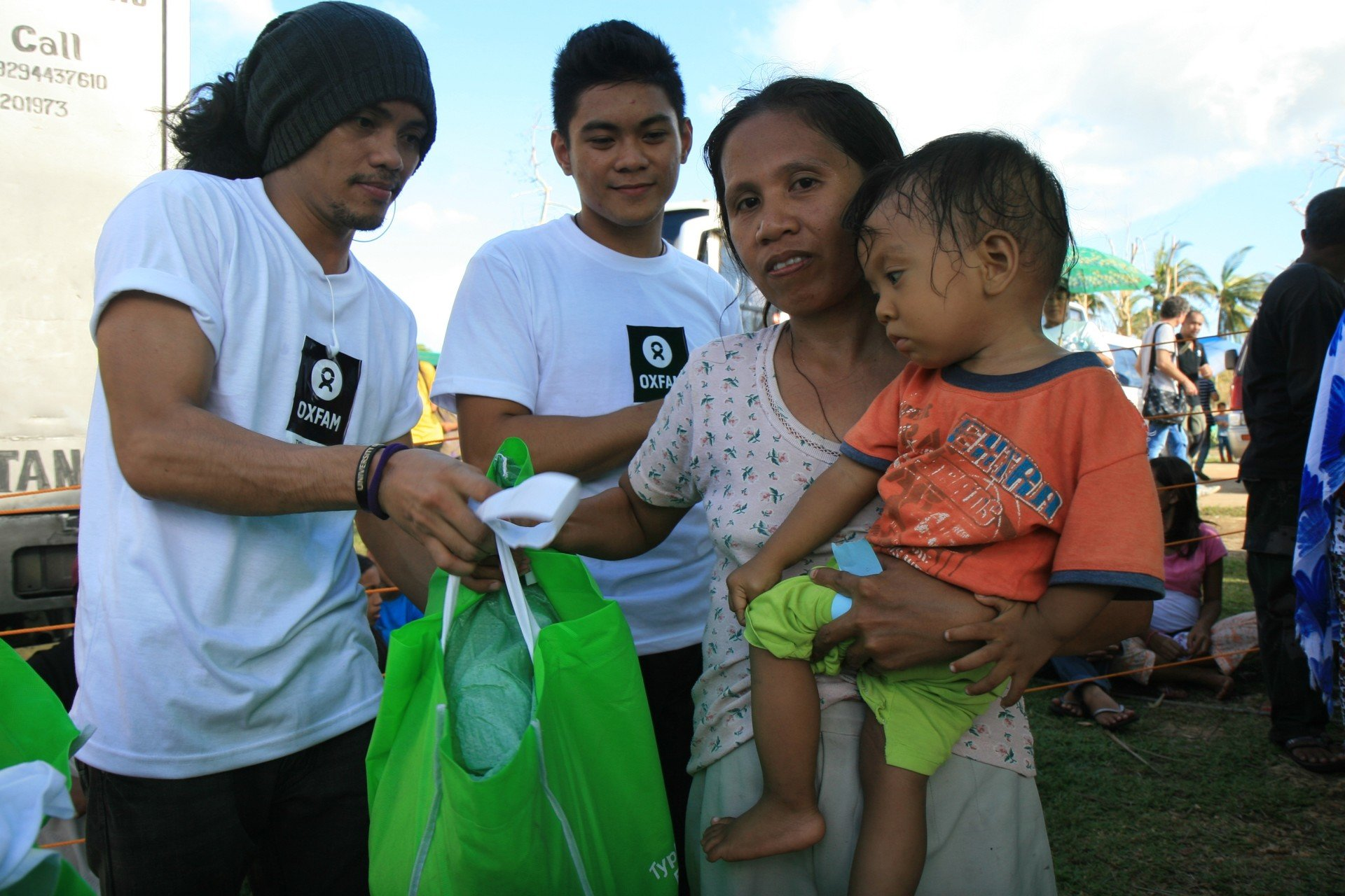 Dolor Moralde receiving a hygiene kit from Oxfam. The hygiene kit contains soap, a blanket, clean underwear and toothbrushes.
